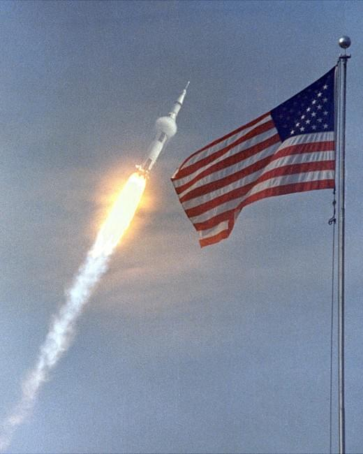 NASA. A Saturn V rocket launches the Apollo 11 crew on the first moon landing mission on July 16, 1969 in this image framed by an American flag. Four days later, Apollo 11 astronauts Neil Armstrong and Buzz Aldrin landed on the moon while crewmate Michael Collins orbited above.