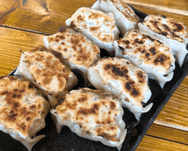 eating gyoza in Echoland Hakuba