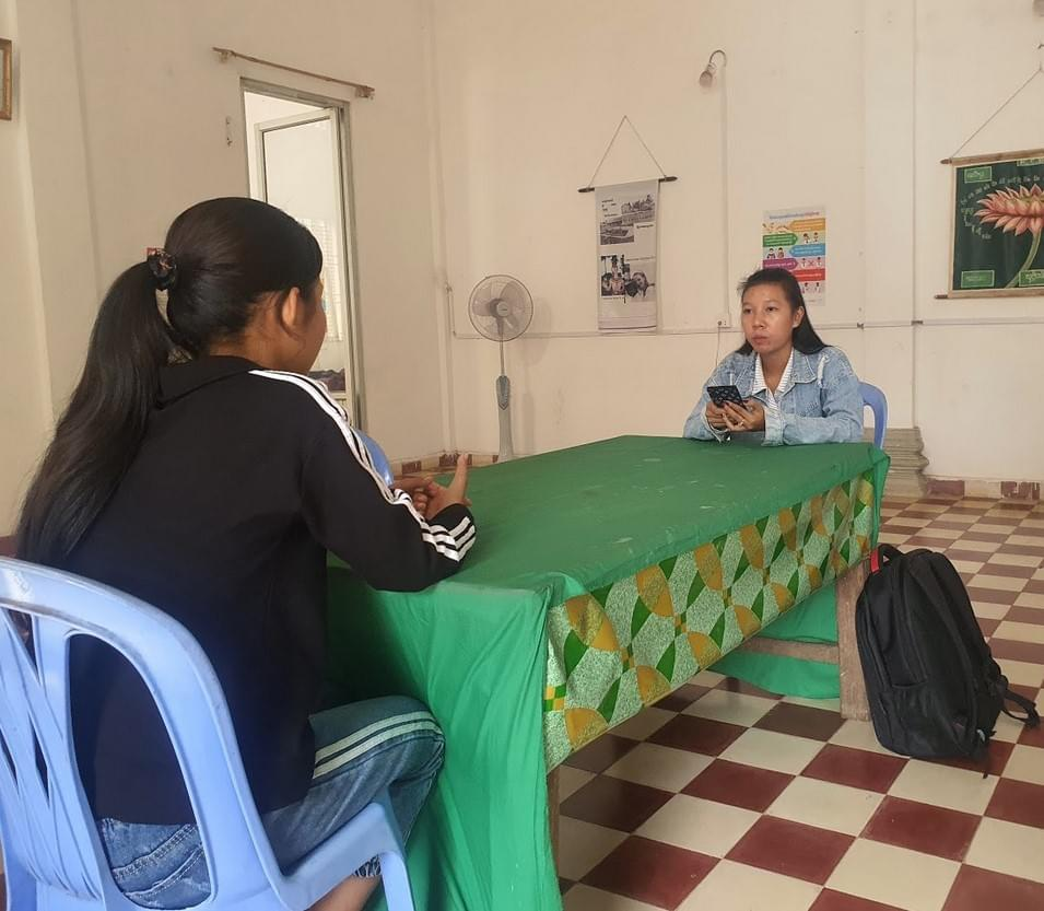 A social worker in Cambodia is doing the initial assessment of a child living in a residential care institution using the Primero mobile app. ©UNICEF/2020/Kauv