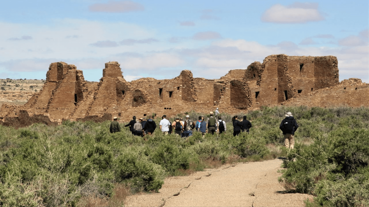 A group including Interior Secretary David Bernhardt and U.S. Sen. Martin Heinrich, D-NM, walk, Monday, May 28, 2019, toward Pueblo Bonito at Chaco Culture National Historical Park. PHOTO: HANNAH GROVER/THE DAILY TIMES