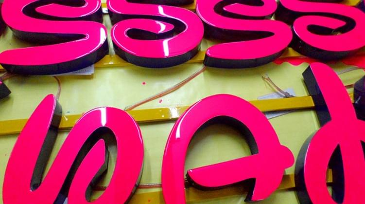 Varisigns Epoxy Resin Letters with red color in production