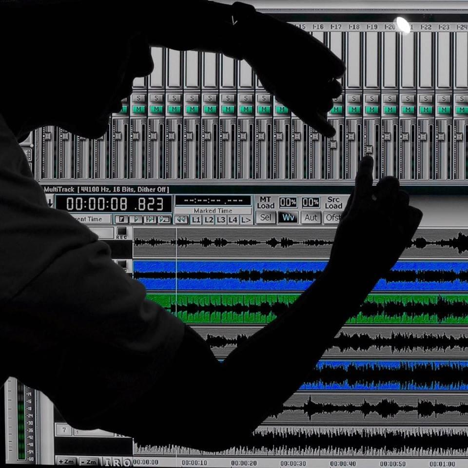 This is an artistic photo expression, showing the engineer manipulating DAW faders.