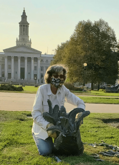 Barbara harvesting kale in Civic Center Park