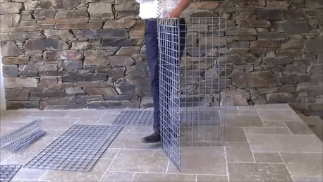 Feed the spiral winder through the wire mesh, joining the panels together