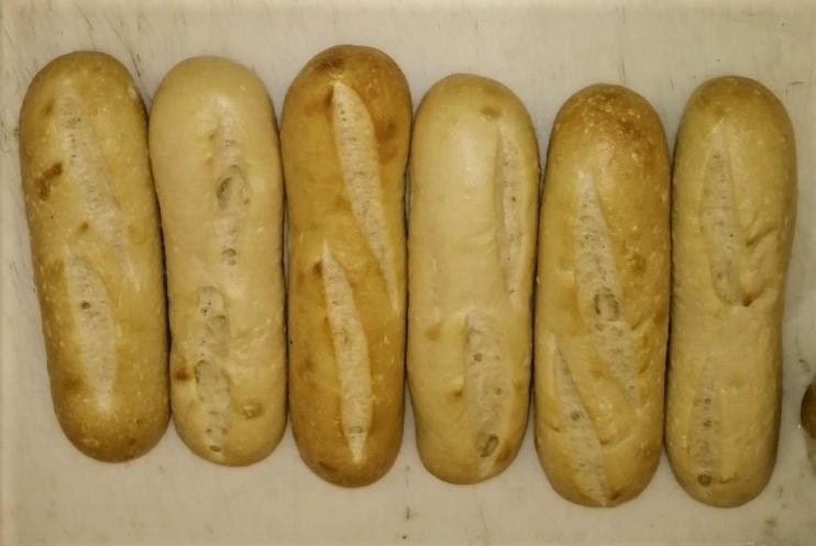 Raymond's Sourdough Mini Baguettes in their par baked state ready for oven browning.