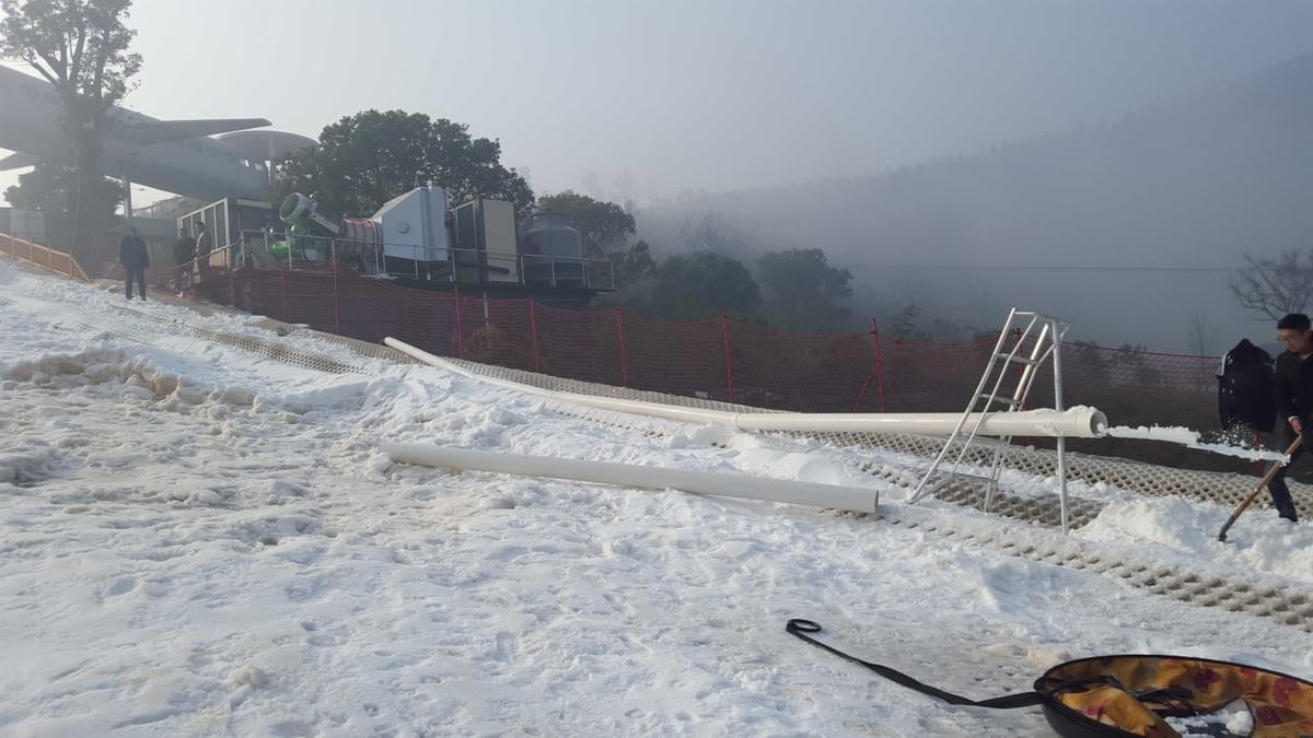 fahrentec snow making system blowing snow in outdoor ski ramp