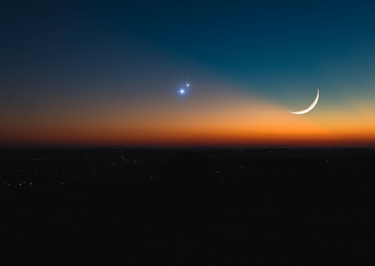 Saturn and Jupiter Conjunction with the New Moon, from mgucci / Getty Images
