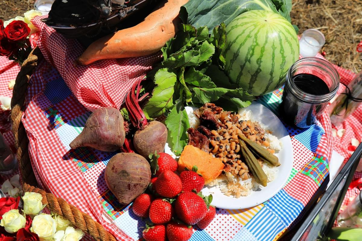 Foods on the Juneteenth altar include beets, strawberries, watermelon, yams and hibiscus tea, as well as a plate of black-eyed peas and cornbread.Credit...Jim Wilson/The New York Times