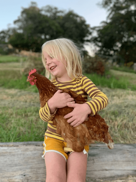 girl with a chicken