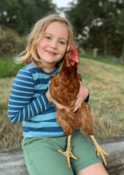 photo of a girl with a chicken
