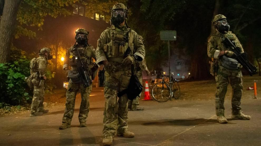 Federal agents patrol in Portland after dispersing a crowd protesting police brutality on Independence Day.Nathan Howard/ZUMA - From an article posted in Mother Jones (linked)