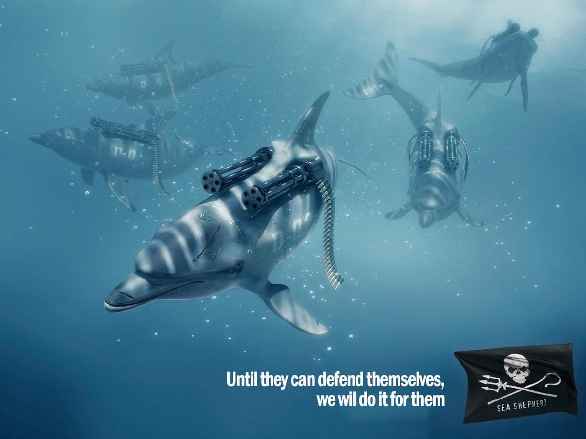 These dolphins appear to be equipped with heavy weaponry to protect themselves from being caught by whalers and the like, almost genetically contoured into their bodies. The slogan declares that until that state of being can happen for dolphins (which it cannot), the people behind the advert would protect them from attack