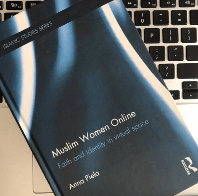a picture of the Muslim Women online book on a laptop keyboard