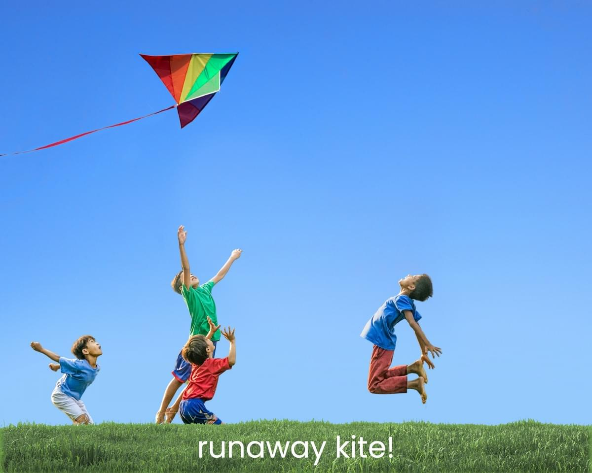 4 kids looking and jumping up into the sky trying to catch the rainbow kite that floats above them