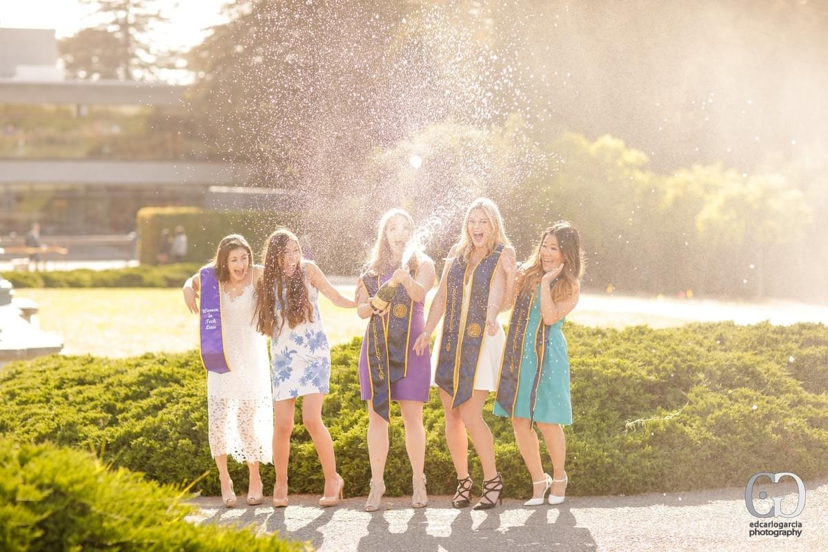 graduation photographer  uc berkeley school of law girls champagne opening