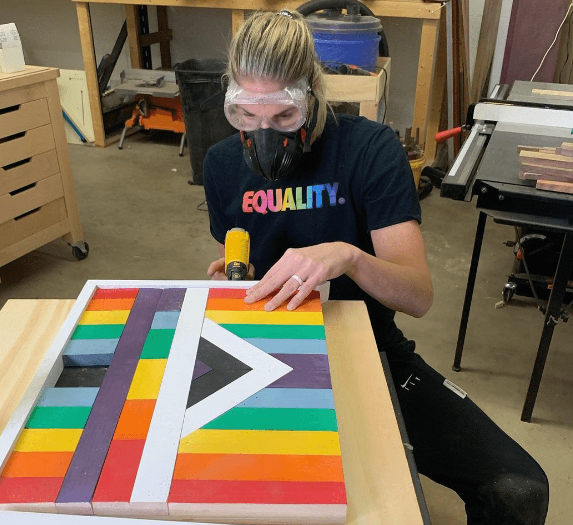 Elena works on rainbow backboard design wearing Equality T-Shit