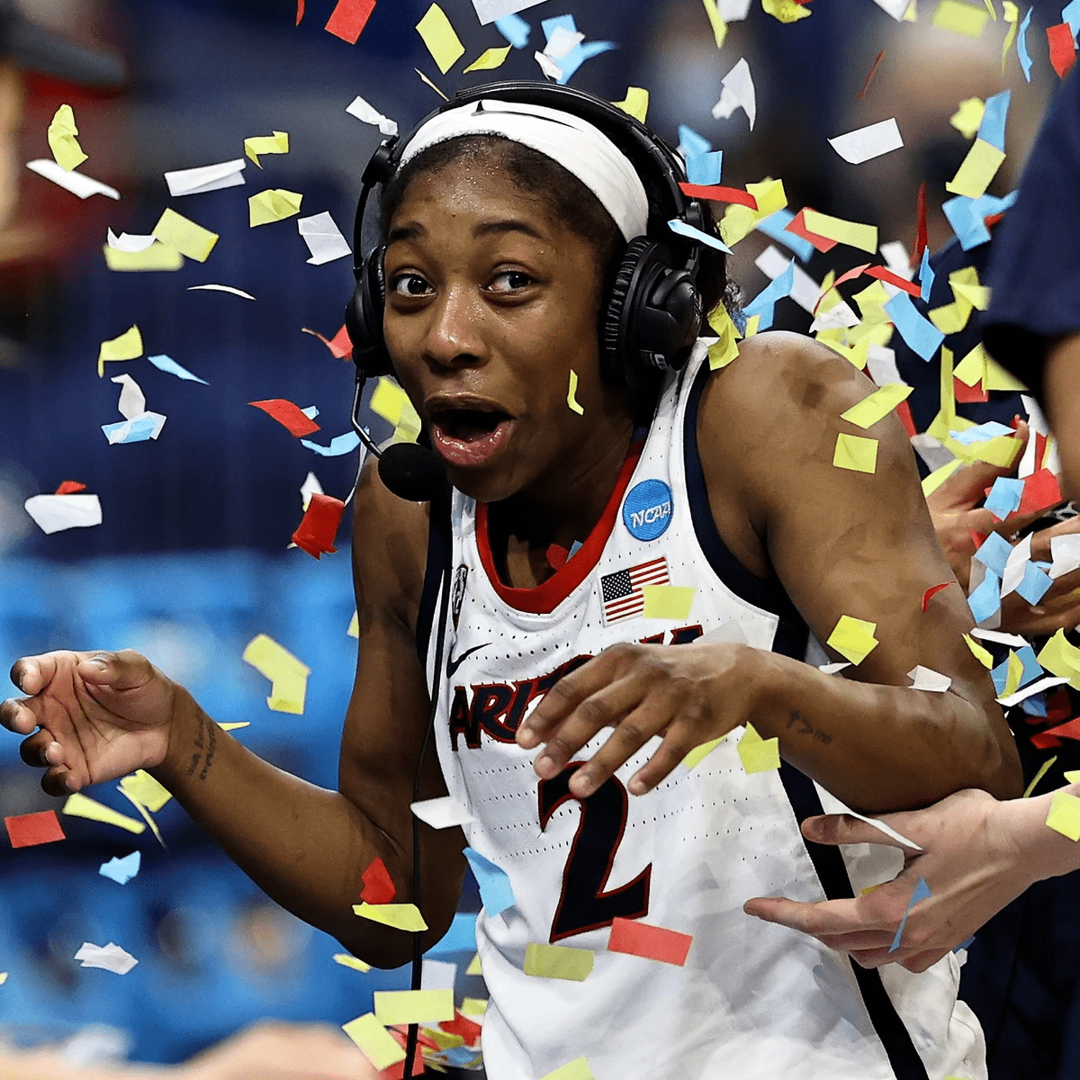 Aari looks happy and surprised as confetti is thrown over her during postgame interview