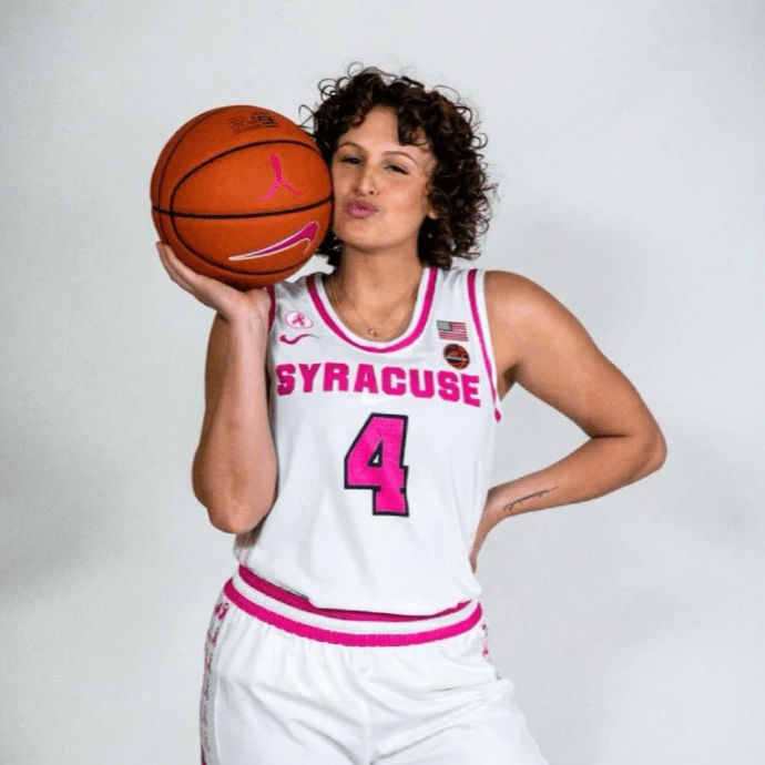 Tiana poses with ball in pink Syracuse jersery