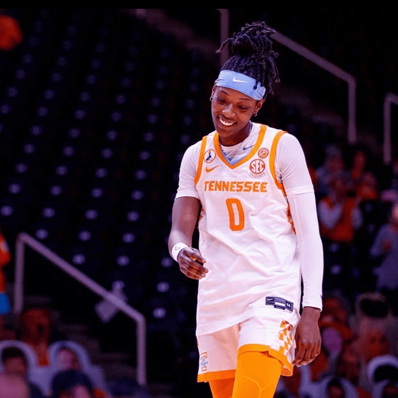 Rennia smiles on the court in Tennessee uniform