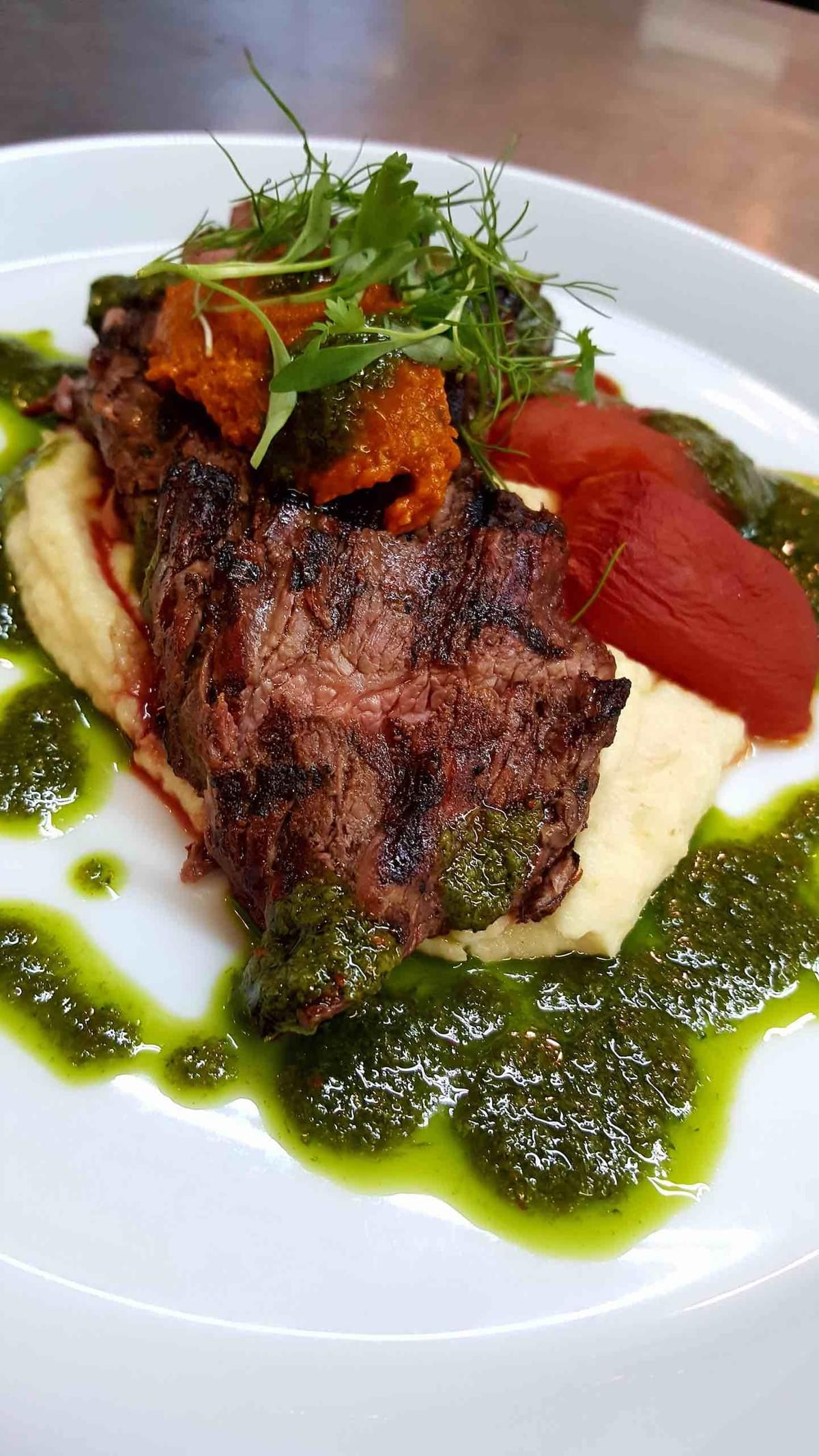 Bavette Steak with Ramp chimichurri, parsnip puree, carrot romesco
