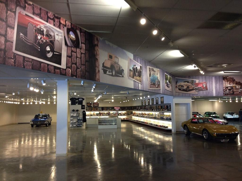Wall Murals circle the primary showroom of Gateway Classic Cars
