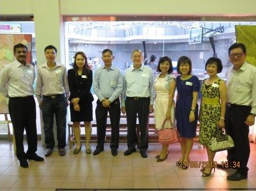 Members of AAS with AAS President Loh Hoon Sun (centre) and  Ms Wendy Choi (in blue), Deputy Director, PA/PMET Division