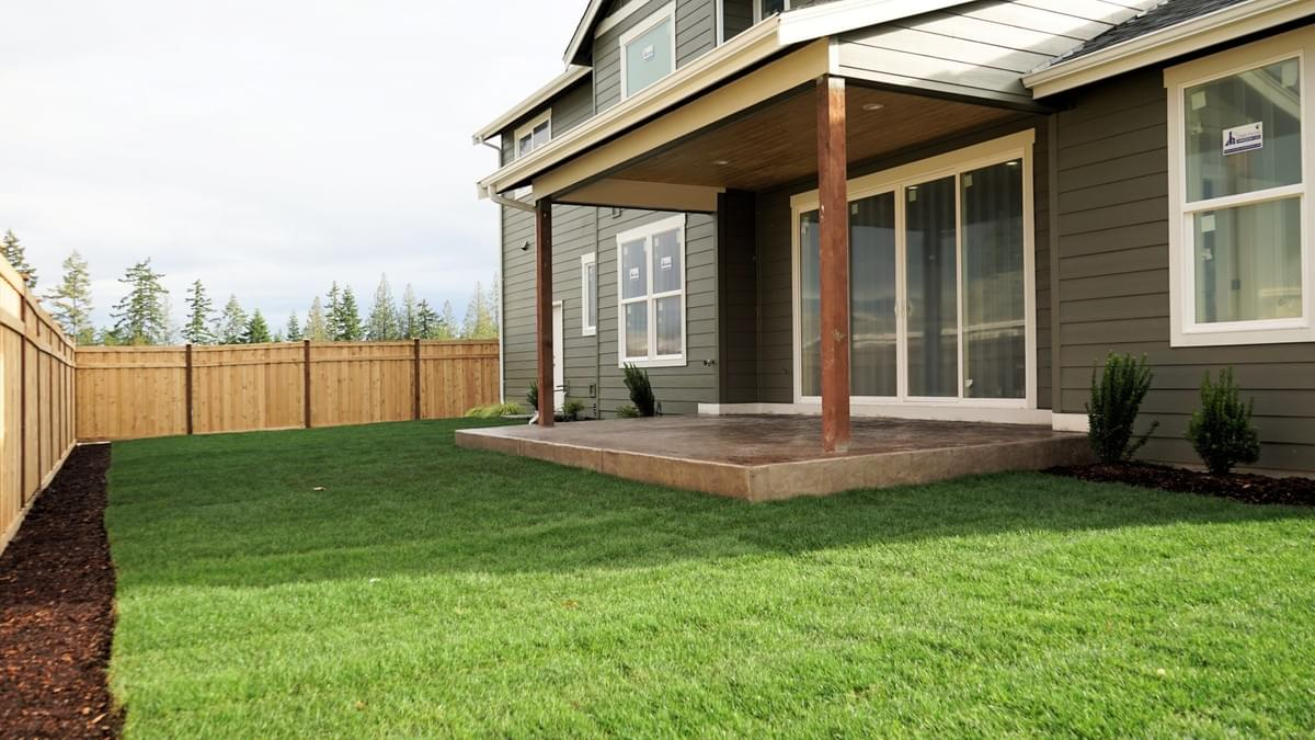 Beautiful fully landscaped and fenced yard with an extra large patio.