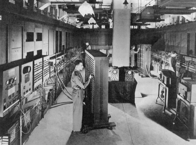 1946 - Cpl. Irwin Goldstein at the Moore School of Electrical Engineering working on the ENIAC which was used to calculate artillery firing