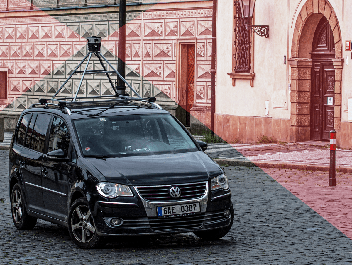 The Mosaic 51 camera on top of a car in Prague's city center, capturing 360 images for mobile mapping purposes.