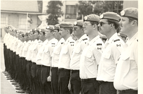 Reviewer stands at attention during parade of Canadian Contingent United Nations Emergency Force Middle East, Ismailia, Egypt, 1978 (3rd from R)