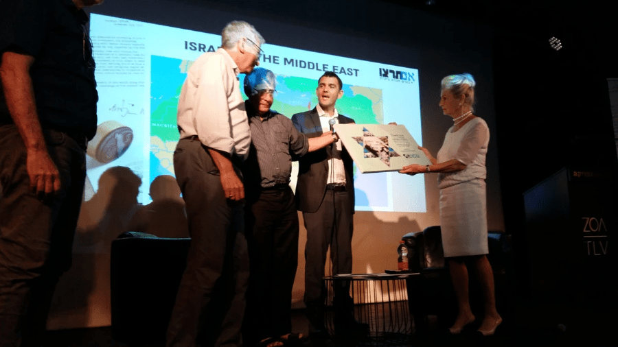 Goldi Steiner, founder and Co-Chair of Canadians for Israel's Legal Rights (CILR.org) receives an award from leaders of Im Turtzu in Tel Aviv for her tireless work in promoting education about Israel's land title deed from the world, the Mandate For Palestine. PHOTO by Mark Vandermaas