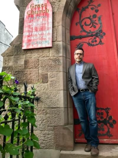 Shakespeare@ Artistic Director Sean Hagerty in front of Grace Church, Jersey City