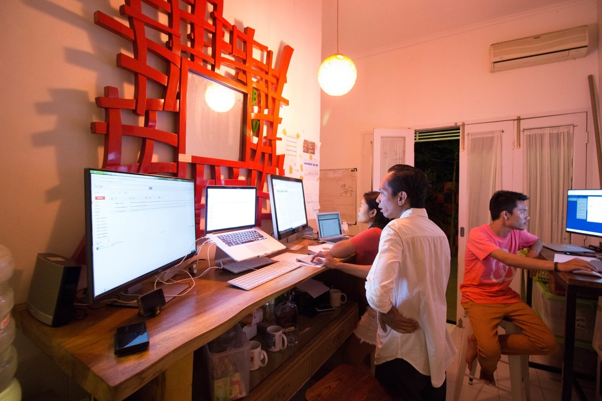 working on computers in villa rentals, Bali Indonesia