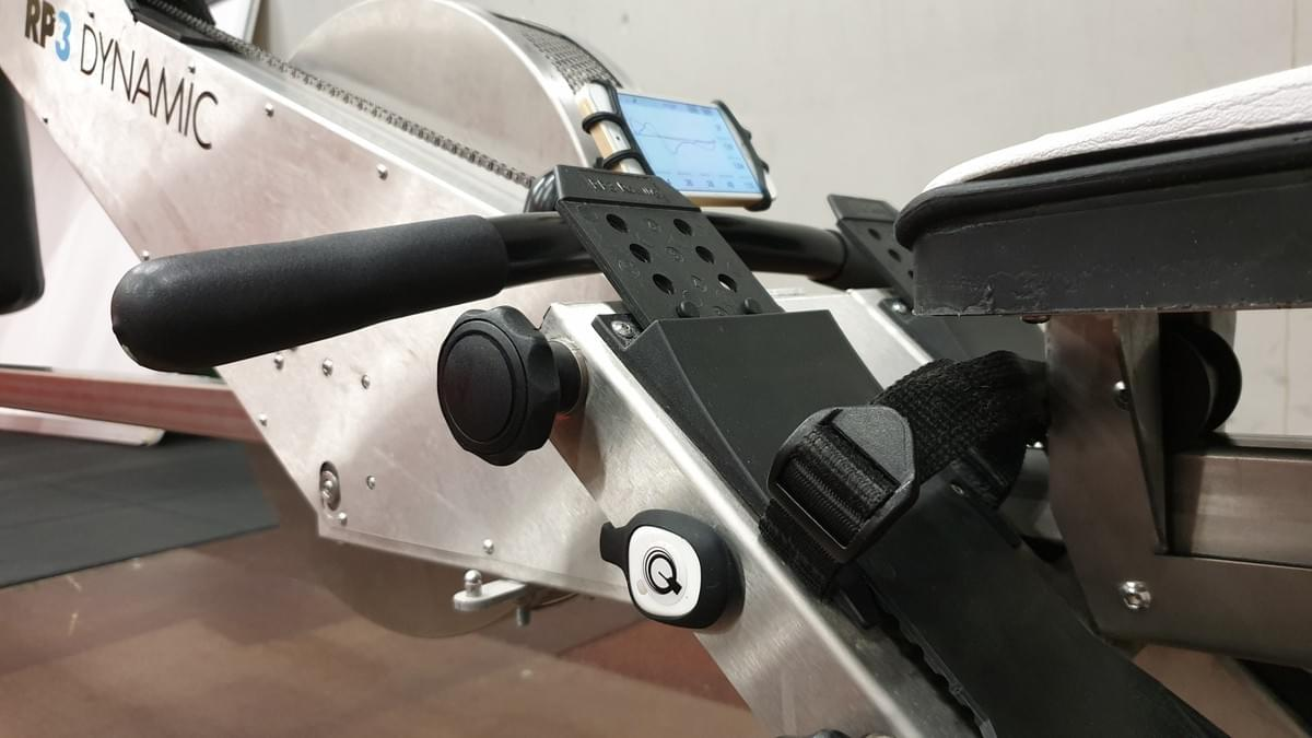 On the RP3 the Quiske pod can be attached to the side of the frame or between the feet. Make sure the blade on the sticker points towards the rower
