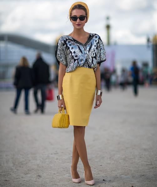 Romanian fashion blogger and designer, Gabriela Atanasov, sports a vintage butterfly sequin top.