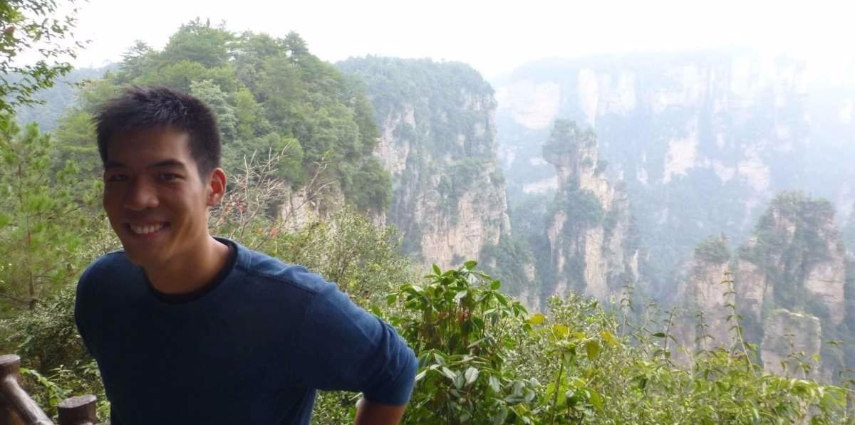 Picture of Zizzle Co-Founder Kevin in the scenic area of China Zhangjiajie standing in front of the Avatar mountains