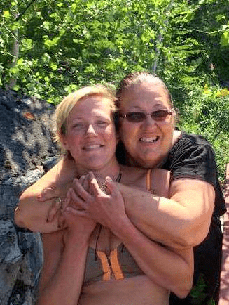 Angela and her mother snuggling on the shores of lake Nemeiben. Photo: Christina Gutzer  The Green Gazette