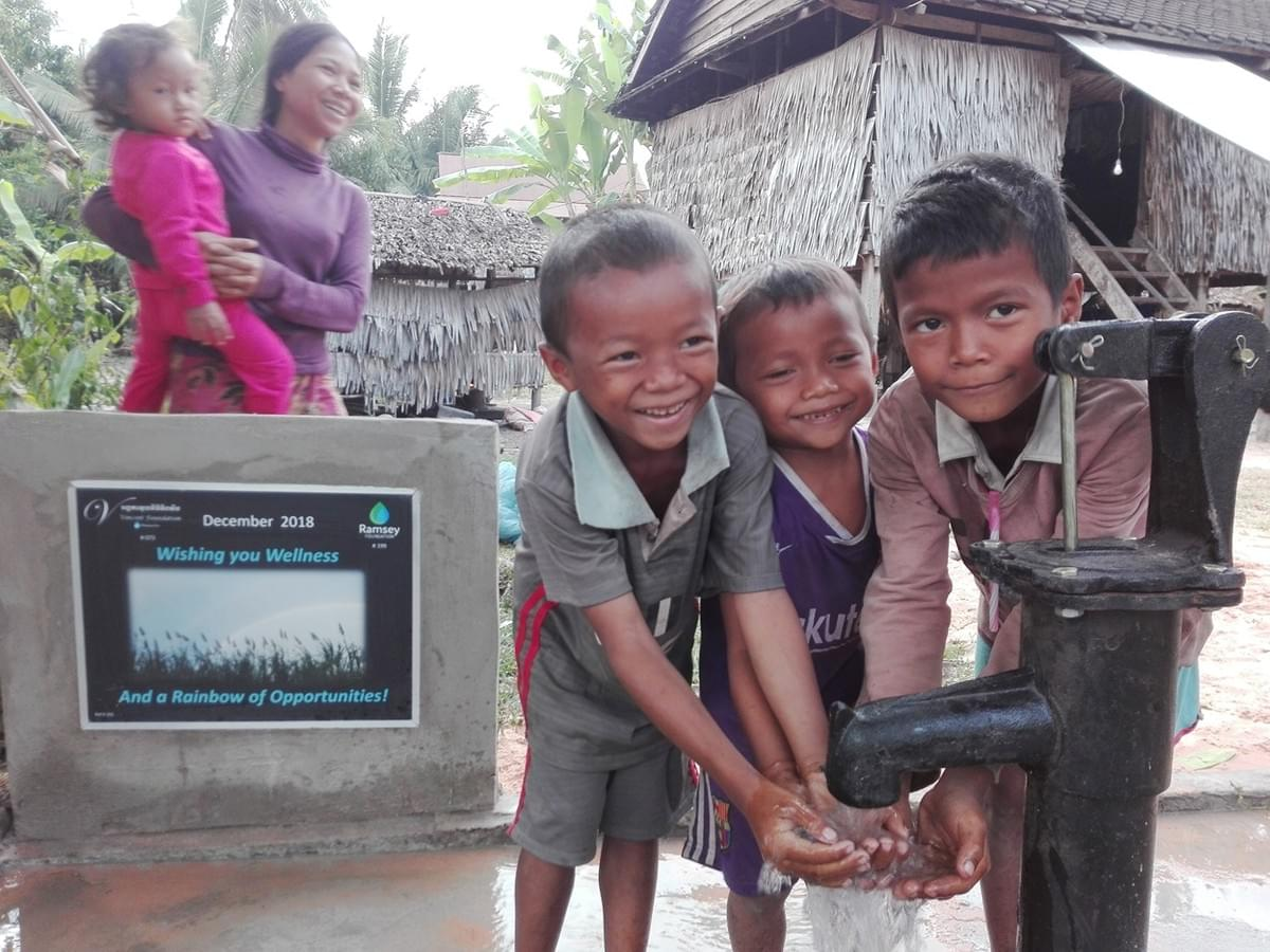 Cambodian children are thrilled to easily access fresh water for the first time thanks to a well donated by Mark & Trina Ramsey Foundation!