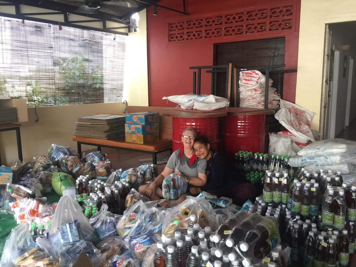 Jill Morse, from our partner, RSSO, and one of their volunteers surrounded by a sea of food items they're aseembling into care packages to be donated to Cambodians in need...clearly al labor of love!