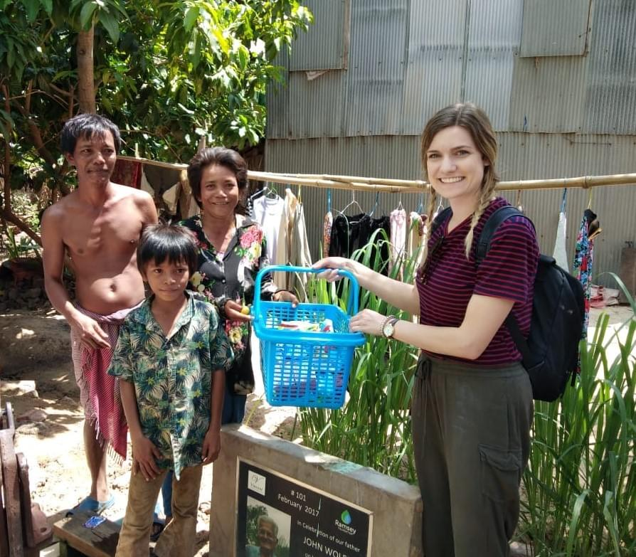 Gifting the Cambodian family that received a water well dedicated to her grandfather, John Wolff.