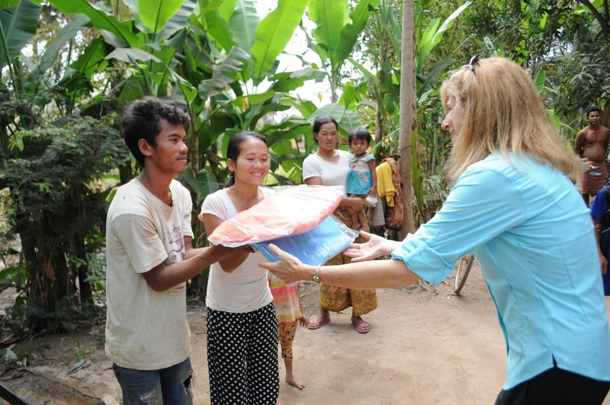 Mosquito Nets being donated to Cambodian families by the Mark & Trina Ramsey Foundation