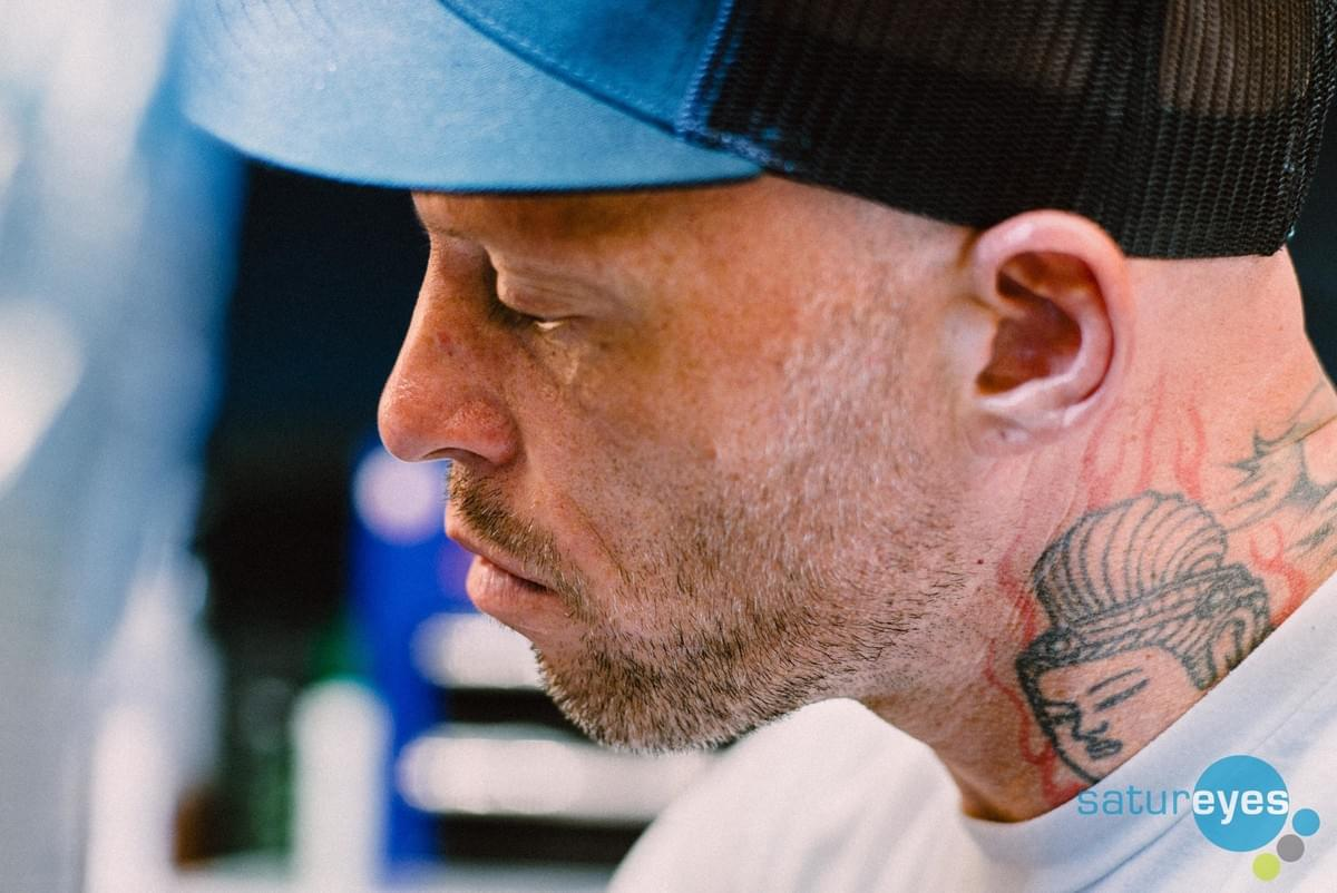 Ami James  from Miami Ink  in his Tattoo Studio, Love Hate Social Club in London gives a tattoo