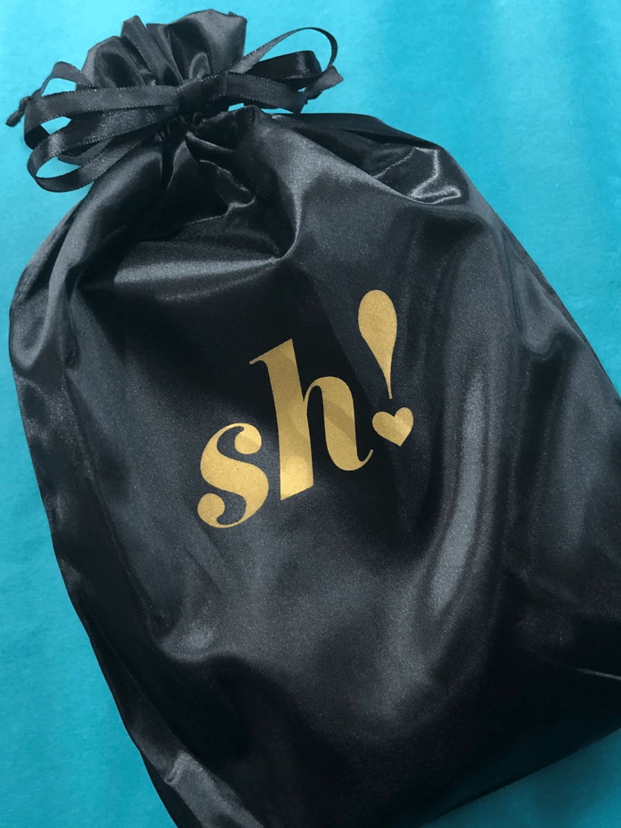 Black satin pouch with gold Sh! logo