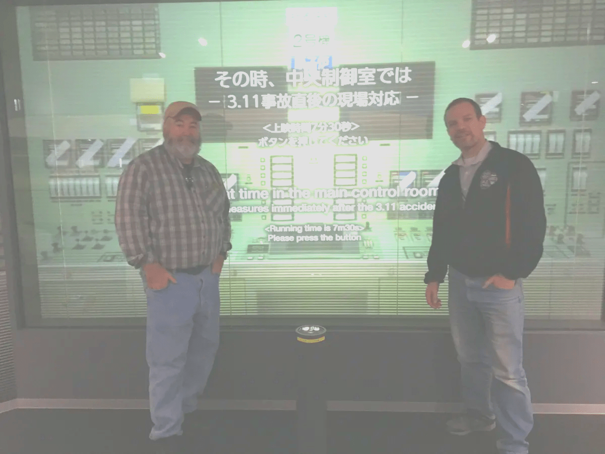 YCAPS Members Hap Belisle and Eric Carter in front of control room display