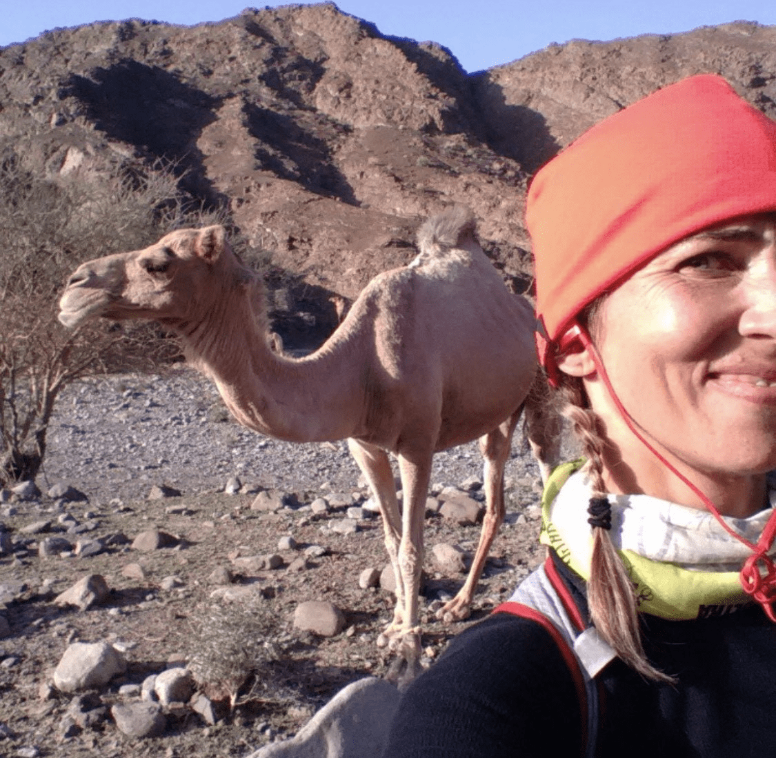 female runner poses for selfie with camel in Dubai UAE