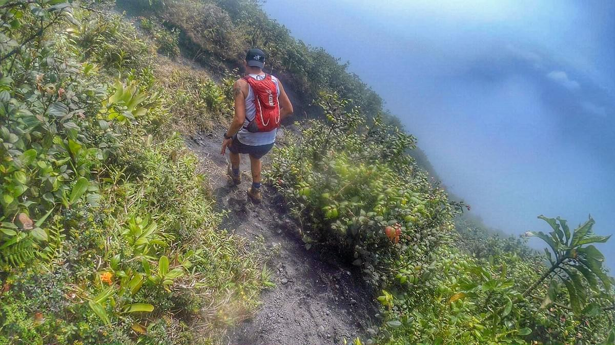 Running a trail that clings to the side of the volcano, a misty drop on the right hand side
