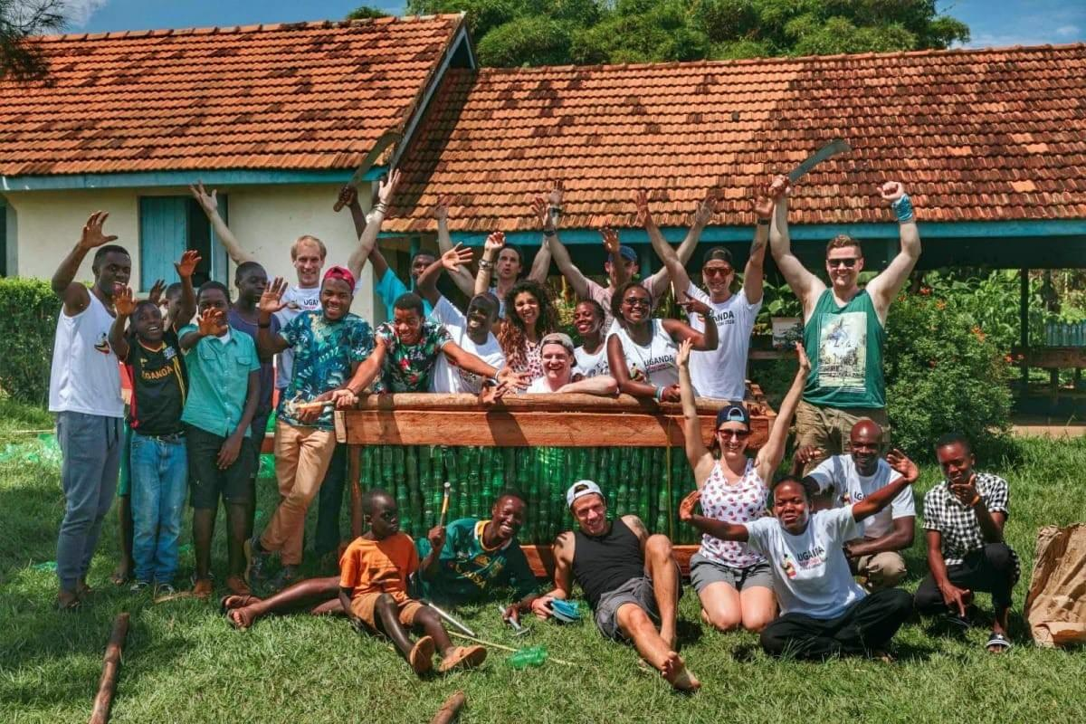 The Uganda Marathon team celebrate completing a build at the Masaka Vocational & Rehabilitation Training Centre