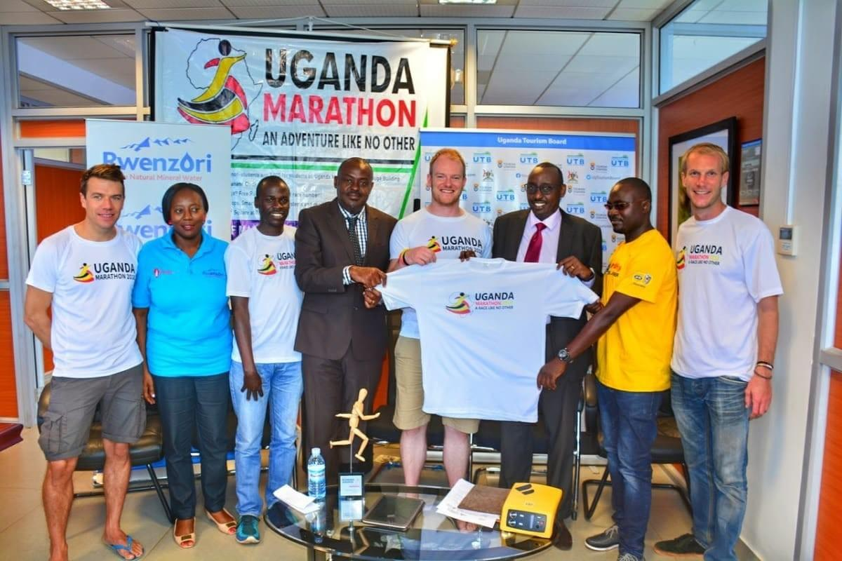 Uganda Marathon team and sponsors pose for a photo during a media day in Kampala