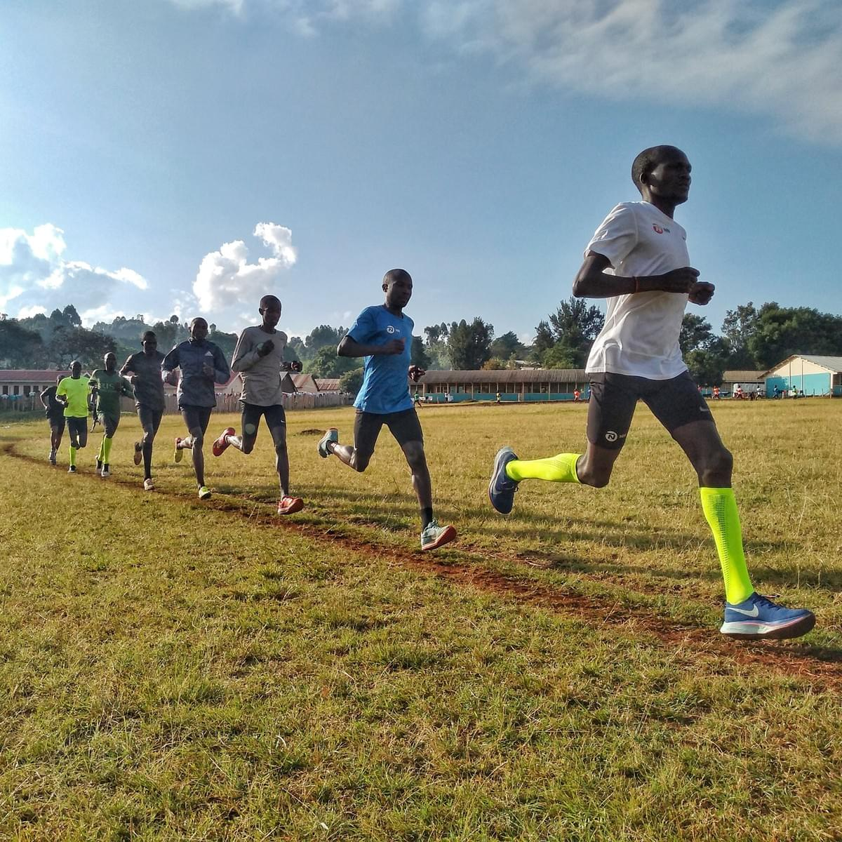 Running with Kiprotich: 2012 London Olympic marathon champion Stephen Kiprotich leads a group of Ugandan runners during  a track session in Kapchorwa, Uganda