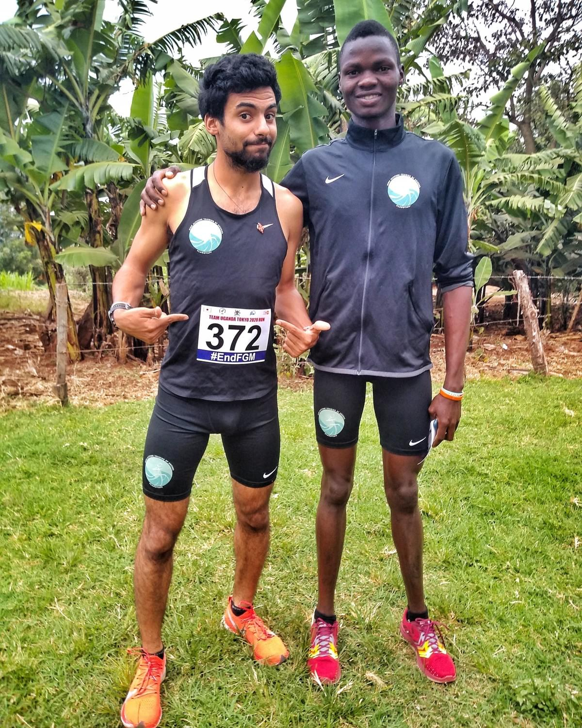 two elite athletes pose for a photo before a race in Kapchorwa, Uganda